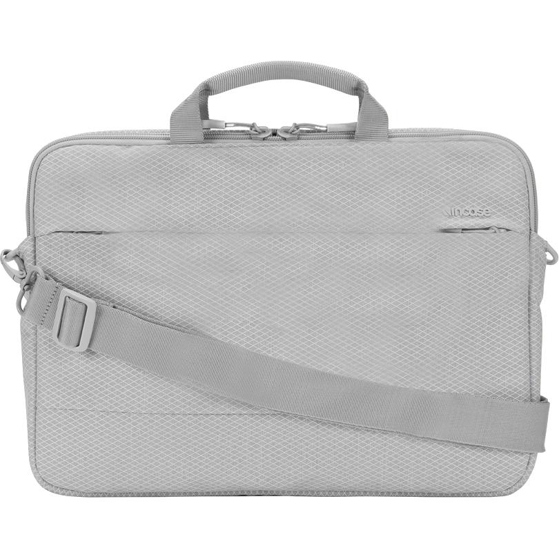 Сумка Incase City Brief для MacBook 15 with Diamond Ripstop серая Cool Gray (INC0100317-CGY)Сумки для ноутбуков<br>Эта лёгкая, стильная и вместительная сумка позволит вам захватить с собой не только ваш MacBook и iPad, но и множество полезных аксессуаров.<br><br>Цвет товара: Серый<br>Материал: 81% нейлон, 19% полиэстер