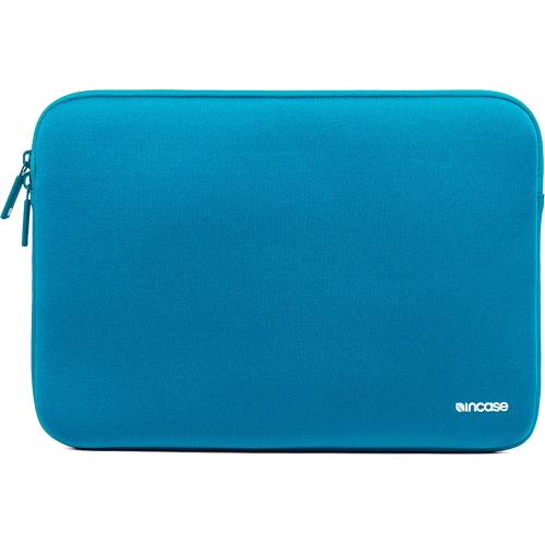 Чехол Incase Neoprene Classic Sleeve для MacBook 15 голубойЧехлы для MacBook Pro 15 Old (до 2012г)<br>Чехол Incase Neoprene Classic Sleeve для MacBook 15  - бирюзовый<br><br>Цвет товара: Голубой<br>Материал: Неопрен, флис