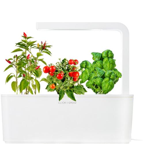 Умный сад Click and Grow Томаты Черри, Перец Чили, Базилик (белая крышка)Умные сады и фермы<br>В системе Умный сад от Click and Grow есть все, что необходимо для нормального роста растения.<br><br>Цвет товара: Белый<br>Материал: Пластик